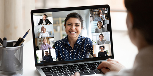 Person attending a virtual meeting on a laptop